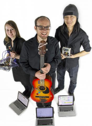 Oregon Electronic Device Orchestra members Olga Oseth, Brandon Skinner, and Churan Feng display their electronic instruments.