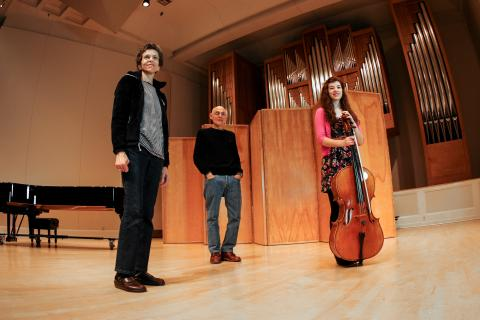 Mari Dembrow, Mark Dembrow, and Makenna Carrico on the Beall Concert Hall stage.