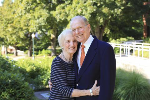 Phyllis and Andrew Berwick embrace outside the Frohnmayer Music Building.