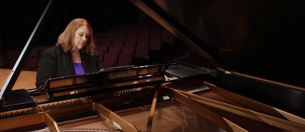 "Professor Claire Wachter gives a demonstration at the piano for her ""Virtual Piano Masterclass"" online instructional series"