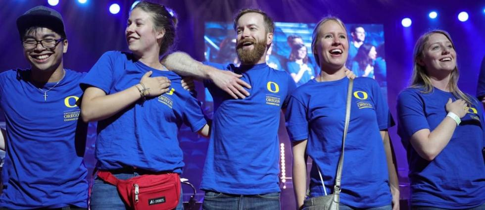 University of Oregon Chamber Choir members (from left) Mark King, Alycia Thatcher, Jared Fischer, Cera Babb and Bailey Halleen sing the national anthem during an awards ceremony at the Grand Prix of Nations in Gothenburg Sweden on August 10, 2019. (photo credit: Grand Prix of Nations/European Choir Games)