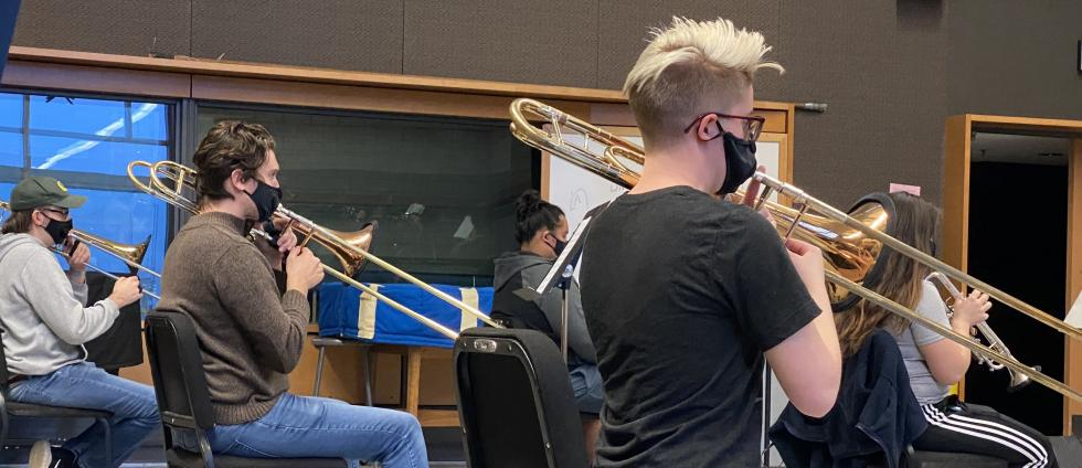 Masked and socially-distanced students return to in-person rehearsals in Aasen-Hull Hall during fall term, 2020 (photo credit: Dennis Llinàs).