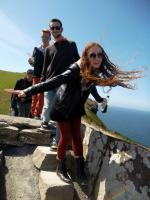 Dasso with choir members Alex Lindquist and Alyse Jamieson at the Cliffs of Moher in 2013