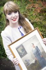Scholarship recipient April Dimmick poses with a photo of Maude Densmore, her benefactor.
